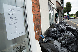 © Licensed to London News Pictures. 12/08/2016. Birmingham, UK. The strike by Birmingham bin men continues as they announce strike action up to Christmas. Pictured, a sign asking residents to remove their rubbish in Brighton Road, Balsall Heath. Photo credit: Dave Warren/LNP