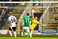 Northern Ireland midfielder Paddy McNair heads towards goal but puts the ball over during the UEFA European 2020 Qualifier match between Northern Ireland and Estonia at National Football Stadium, Windsor Park, Northern Ireland on 21 March 2019.