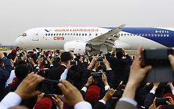 May 5, 2017 - China's homegrown large passenger plane C919 taxies on a runway after its maiden flight in Shanghai, east China, May 5, 2017. China's homegrown large passenger plane, the C919, took to the skies on Friday in the eastern city of Shanghai, marking a great improvement of China's innovative capability and high technology in aviation and aerospace industry. (Credit Image: © Fang Zhe/Xinhua via ZUMA Wire)