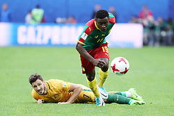 2017?6?23?.   ????????——?????????????????.    6?22????????????????????????????????.    ??????????????2017????????B???????????1?1?????????.    ?????????..(SP)RUSSIA-ST. PETERSBURG-2017 FIFA CONFEDERATIONS CUP-CMR VS AUS..(170623) -- ST. PETERSBURG, June 23, 2017  Collins Fai (top) of Cameroon vies with Mathew Leckie of Australia during the group B match between Cameroon and Australia of the 2017 FIFA Confederations Cup in St. Petersburg, Russia, on June 22, 2017. The match ended with a 1-1 tie.  7 9854294892 (Credit Image: © Xu Zijian/Xinhua via ZUMA Wire)
