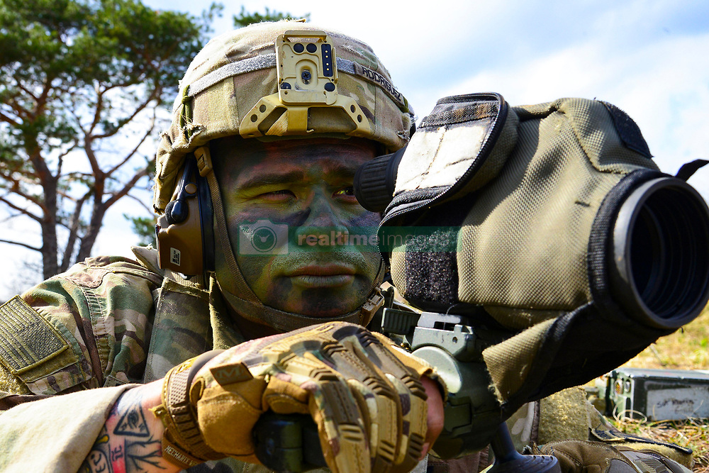 March 25, 2019 - Postojna, Slovenia - A U.S. Army Paratrooper assigned to 1st Battalion, 503rd Infantry Regiment, 173rd Airborne Brigade, uses his spotter scope to see the impact of his snipers bullet during sniper training as part of Exercise Eagle Sokol at Pocek Range in Slovenia, Mar. 25, 2019. Exercise Eagle Sokol is a bilateral training exercise with the Slovenian Armed Forces focused on the rapid deployment and assembly of forces and team cohesion with weapon systems tactics and procedures. Exercises such as this build a foundation of teamwork and readiness between allied NATO countries. The 173rd Airborne Brigade is the U.S. Army Contingency Response Force in Europe, capable of projecting ready forces anywhere in the U.S. European, Africa or Central Commands' areas of responsibility. (Credit Image: © U.S. Army/ZUMA Wire/ZUMAPRESS.com)
