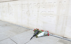 Flowers left outside New Scotland Yard in London, after seven people were arrested in raids in London, Birmingham and elsewhere linked to the Westminster terror attack.