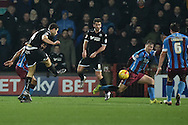 Yanic Wildschut of Wigan Athletic kicks towards goal during the Sky Bet League 1 match between Scunthorpe United and Wigan Athletic at Glanford Park, Scunthorpe, England on 2 January 2016. Photo by Ian Lyall.