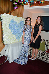 Left to right, LAVINIA BRENNAN and LADY NATASHA RUFUS ISAACS at a party hosted by Lady Kinvara Balfour, Lavinia Brennan and Lady Natasha Rufus Isaacs to celebrate the Beulah French Sole Collaboration in aid of the UN Blue Heart Campaign, held at George, 87-88 Mount Street, London on 10th December 2013.