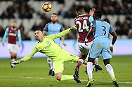 Goalkeeper Wilfredo Caballero of Manchester City stretches to make a save from Ashley Fletcher of West Ham Utd. Premier league match, West Ham Utd v Manchester city at the London Stadium, Queen Elizabeth Olympic Park in London on Wednesday 1st February 2017.<br /> pic by John Patrick Fletcher, Andrew Orchard sports photography.