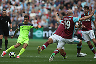 Philippe Coutinho of Liverpool (L) shoots and scores Liverpool's second goal. Premier league match, West Ham Utd v Liverpool at the London Stadium, Queen Elizabeth Olympic Park in London on Sunday 14th May 2017.<br /> pic by Steffan Bowen, Andrew Orchard sports photography.