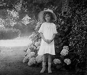 French girl in a garden. Circa 1900