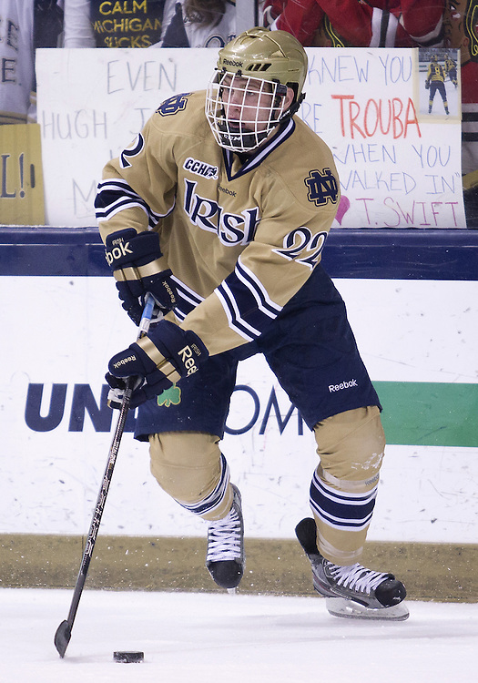 February 09, 2013:  Notre Dame left wing Mario Lucia (22) skates with the puck during NCAA Hockey game action between the Notre Dame Fighting Irish and the Michigan Wolverines at Compton Family Ice Arena in South Bend, Indiana.  Notre Dame defeated Michigan 6-4.