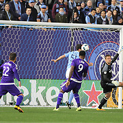Cyle Larin, Orlando, heads the winning goal as goalkeeper Josh Saunders, NYCFC, fails to cut out a cross,  during the New York City FC Vs Orlando City, MSL regular season football match at Yankee Stadium, The Bronx, New York,  USA. 18th March 2016. Photo Tim Clayton
