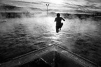 A child jumps into the hot spring fed pool during the cold of winter in Saratoga Spings Utah, December 2007.