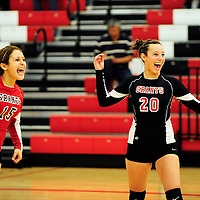 110612  Adron Gardner<br /> <br /> Grants Pirates Kami Roxanne Autrey (15) and Sydney Garcia (20) celebrate after the final point puts them over the Belen Eagles in the 4A volleyball district tournament in Grants Tuesday.