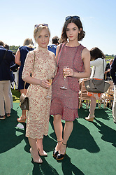 Left to right, CIARA CHARTERIS and SAI BENNET at the St.Regis International Polo Cup at Cowdray Park, Midhurst, West Sussex on 16th May 2015.