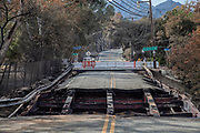 Damaged Bridge along Mulholland HIghway, the steel beams melted from the extreme heat. The Woolsey wildfire started on November 8, 2018 and has burned over 98,000 acres of land, destroyed an estimated 1,100 structures and killed 3 people in Los Angeles and Ventura counties and the especially hard hit area of Malibu. California, USA