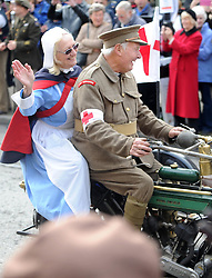© Licensed to London News Pictures. 12/10/2014. Pickering, UK The annual wartime weekend in Pickering, North Yorkshire. People dress in 1940s period themed outfits and attend parades through the small Yorkshire town which has a traditional steam railway as would have been used in the 1940s. // Pictured:  The military vehicle parade through Pickering Market Place - a motorcyle stretcher. Photo credit :  HARRY ATKINSON/LNP