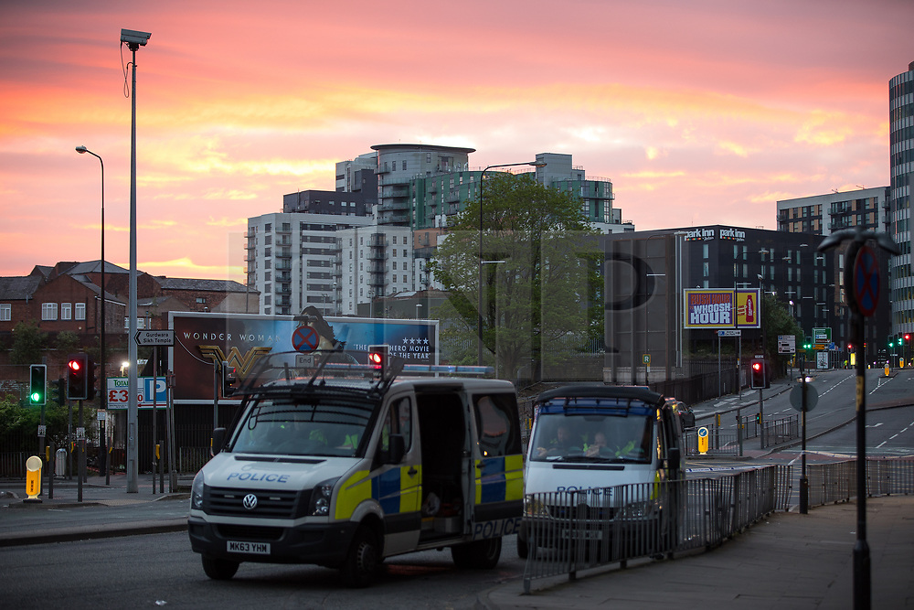 © Licensed to London News Pictures . FILE PICTURE DATED 23/05/2017 as Manchester prepares to mark a year since the Manchester Arena terror attack . Manchester, UK. Sunrise as viewed from Trinity Way , opposite the Manchester Arena . Police and other emergency services are seen near the Manchester Arena after Salman Abedi murdered 22 and injured dozens more at an Ariana Grande concert at Manchester Arena. Photo credit : Joel Goodman/LNP