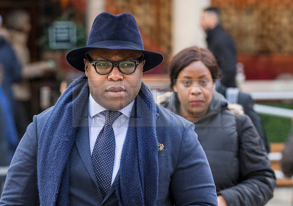 © Licensed to London News Pictures. 23/02/2018. London, UK. Lanre Haastrup (L) and Takesha Thomas (R), parents of 11-month-old Isaiah Haastrup, arrive at the High Court in London. Judges are set to rule on whether doctors at King's College Hospital can withdraw life support for Isaiah who suffered severe brain damage. Photo credit: Rob Pinney/LNP