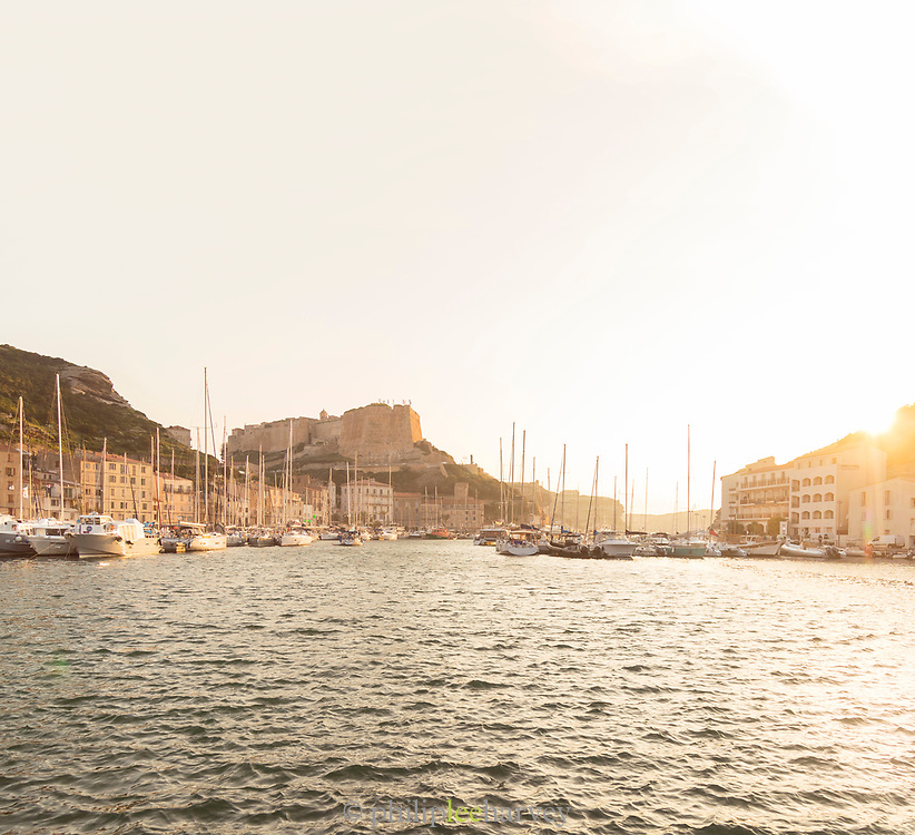 Sunset over harbor, with yachts and boats, Bonifacio, Corsica, France