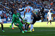 Darren Bent of Derby County ® sees his shot at goal saved by Huddersfield Town Goalkeeper Alex Smithies. Skybet football league championship match, Huddersfield Town v Derby county at the John Smith's stadium in Huddersfield, Yorkshire on Saturday 18th April 2015.<br /> pic by Chris Stading, Andrew Orchard sports photography.