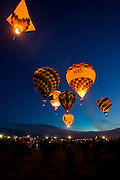 Crowds gather to watch the Dawn Patrol lift off at the Albuquerque International Balloon Fiesta