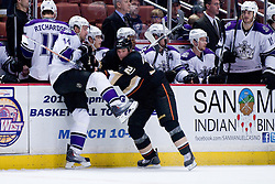 Justin Williams (Los Angeles Kings, #14) vs Sheldon Brookbank (Anaheim Ducks, #21) during ice-hockey match between Anaheim Ducks and Los Angeles Kings in NHL league, Februar 23, 2011 at Honda Center, Anaheim, USA. (Photo By Matic Klansek Velej / Sportida.com)