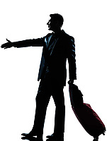 one caucasian man one caucasian business traveler man handshake  with suitcase  full length silhouette in studio isolated on white background