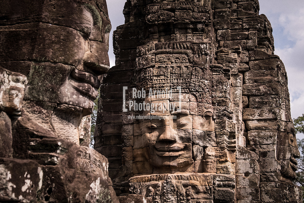 Some of the smiling stone faces on the towers at Bayon Temple in Angkor Thom in Siem Reap, Cambodia.