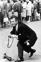 British photographer Terry Fincher seen at work during the 1960's in London.