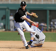 GLENDALE, AZ - MARCH 5:  Brent Lillibridge #18 of the Chicago White Sox turns a double play over a sliding Doug Mientkiewicz #13 of the Los Angeles Dodgers on March 5, 2010 at The Ballpark at Camelback Ranch in Glendale, Arizona. (Photo by Ron Vesely)