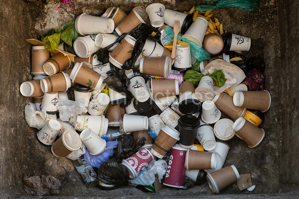 An industrial bin fill up with takeaway coffee cups on 6th March 2021 in Folkestone, United Kingdom. Coffee cups make up the majority of the contents of a street rubbish bins across the country.