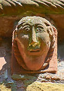 Norman Romanesque exterior corbel no 78 - sculpture of mans head with elongated face from the outside of the west knave. The Norman Romanesque Church of St Mary and St David, Kilpeck Herefordshire, England. Built around 1140 .<br /> <br /> Visit our MEDIEVAL PHOTO COLLECTIONS for more   photos  to download or buy as prints https://funkystock.photoshelter.com/gallery-collection/Medieval-Middle-Ages-Historic-Places-Arcaeological-Sites-Pictures-Images-of/C0000B5ZA54_WD0s