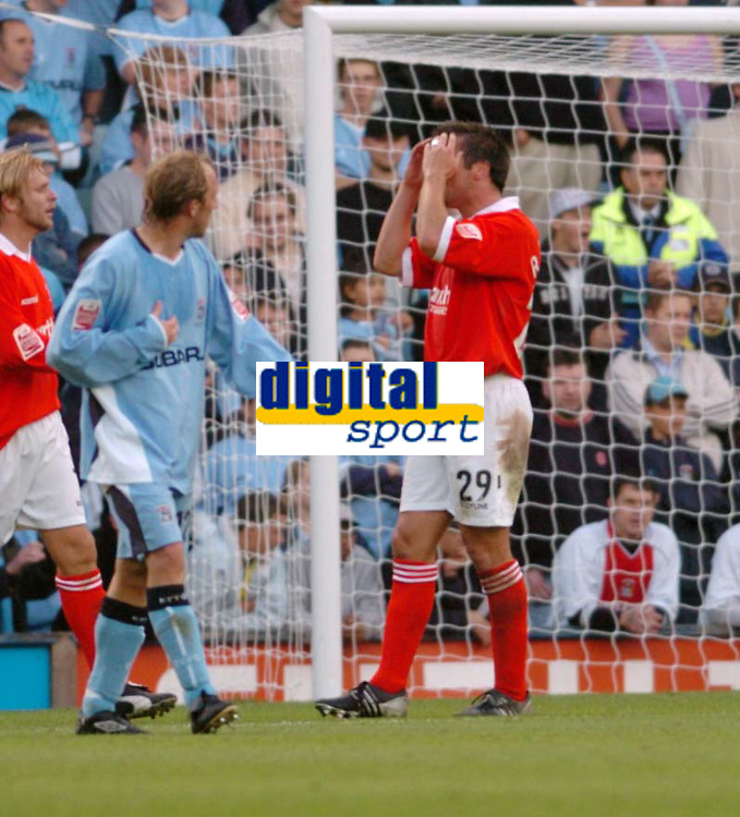 Photo. Leigh Quinnell.  Coventry City v Rotherham United. Coca Cola championship. 18/09/2004.<br /> Rotherhams Richard Barker misses a chance.