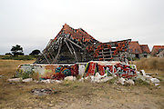 Ruins of houses in Pirou-Plage, the Mayor of Pirou warns about tripping hazards on the site.