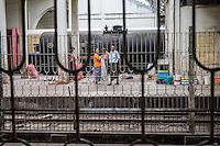 YANGON, MYANMAR - CIRCA DECEMBER 2013: Passengers waits on the train platform at the Yangon Central Railway Station