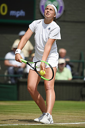 © Licensed to London News Pictures. 12/07/2018. London, UK. Jelena Ostapenko of Latvia plays Angelique Kerber of Germany in the women's semi-finals round singles draw of the Wimbledon Tennis Championships 2018, at the All England Lawn Tennis and Croquet Club. Photo credit: Ray Tang/LNP