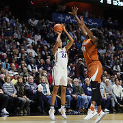 UNCASVILLE, CONNECTICUT- DECEMBER 4:  Napheesa Collier #24 of the Connecticut Huskies shoots for three while defended by Joyner Holmes #24 of the Texas Longhorns during the UConn Huskies Vs Texas Longhorns, NCAA Women's Basketball game in the Jimmy V Classic on December 4th, 2016 at the Mohegan Sun Arena, Uncasville, Connecticut. (Photo by Tim Clayton/Corbis via Getty Images)