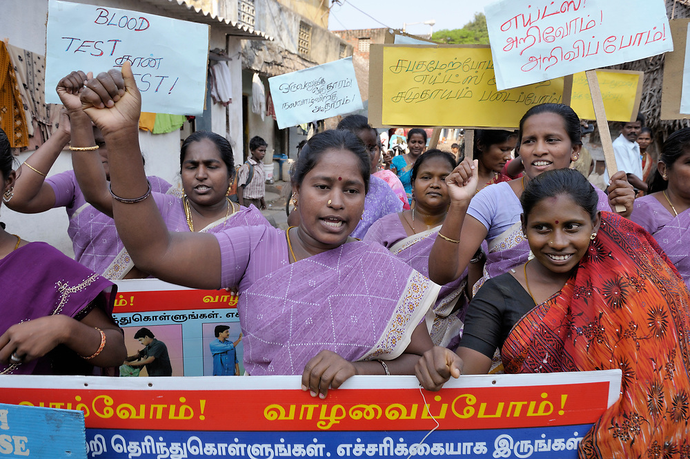 Women in the Rangoon Street neighborhood of Chennai, India, march through the narrow streets near their homes to help educate their neighbors about HIV and AIDS.