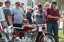 An antique Ducati gets judged at the AMCA Sunshine Chapter Swap Meet during Daytona Beach Bike Week. FL. USA. Saturday March 11, 2017. Photography ©2017 Michael Lichter.