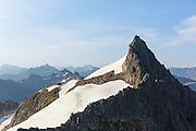 This montain named Kolåstinden is one of several montains called Sunnmørsalpene, and is located on the west coast of Norway   Kolåstinden på 1428 moh er rangert som det 28 høyeste fjellet i norge, og er en del av de spektakulære Sunnmørsalpene.