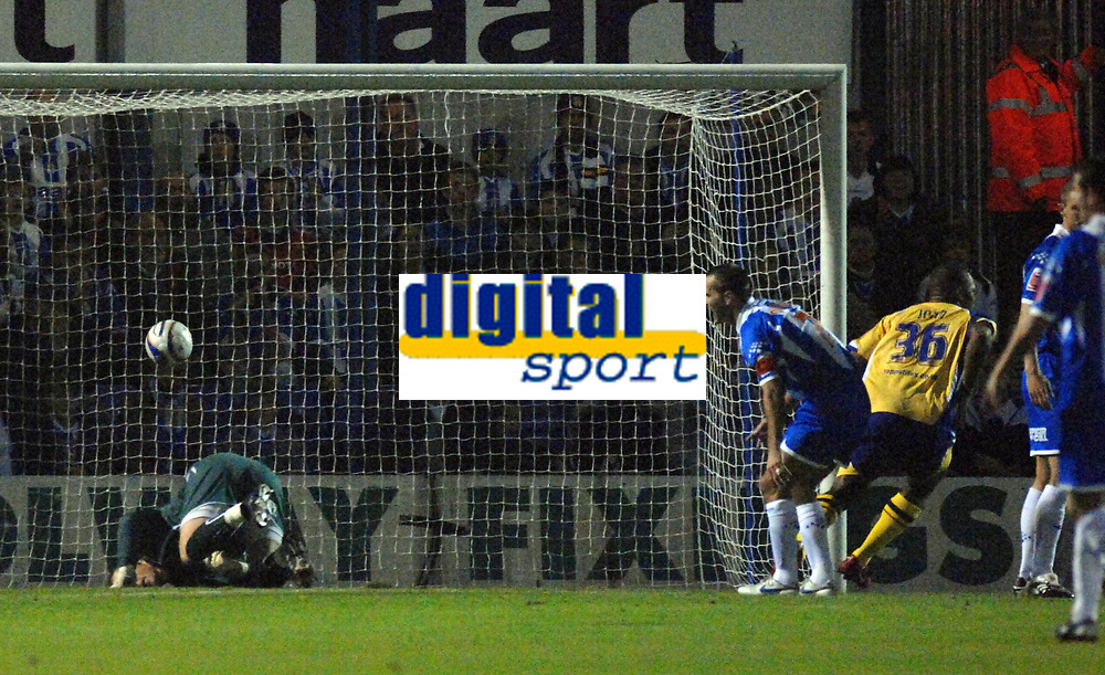 Photo: Ashley Pickering/Sportsbeat Images.<br /> Colchester United v Leicester City. Coca Cola Championship. 03/11/2007.<br /> Collins John's (yellow) shot beats Colchester goalie Dean Gerken (L) to open the scoring for Leicester