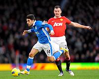20111226: LONDON, UK - Barclays Premier League 2011/2012:  <br /> Manchester United vs Wigan Athletic.<br /> In photo: Jordi Gomez of Wigan Athletic runs past Darron Gibson of Manchester United.<br /> PHOTO: CITYFILES