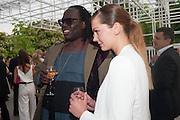 DAVID OKUMU; ROSIE LOWE; , The Serpentine Summer Party 2013 hosted by Julia Peyton-Jones and L'Wren Scott.  Pavion designed by Japanese architect Sou Fujimoto. Serpentine Gallery. 26 June 2013. ,