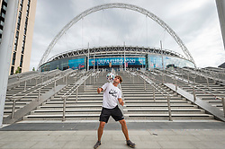 © Licensed to London News Pictures. 10/06/2021. LONDON, UK.  London, UK.  10 June 2021.  Footballer Scott Penders practices juggling a football outside Wembley Stadium for the upcoming 2020 UEFA European Football Championship, commonly known as Euro 2020, where he will be performing on the Wembley pitch for England games and the final. The tournament was postponed from 2020 due to the COVID-19 pandemic in Europe and rescheduled for 11 June to 11 July 2021 with matches to be played in 11 cities. Wembley Stadium will host certain group matches including England v Croatia on 13 June, as well as the semi-finals and final itself.  Photo credit: Stephen Chung/LNP