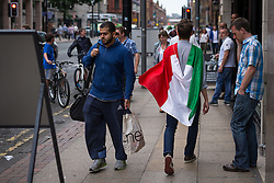 © Licensed to London News Pictures . 14/06/2014 .  Manchester , UK . A man draped in an Italy flag in Manchester City Centre this evening (Saturday 14th June 2014) as England prepare to play Italy in their first match of the 2014 World Cup , in Brazil . Photo credit : Joel Goodman/LNP