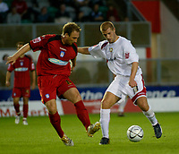 Photo: Marc Atkins.<br /> Milton Keynes Dons v Colchester United. Carling Cup. 22/08/2006.Ben Harding (R) of MK Don's holds off Kevin Watson of Colchester United.
