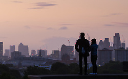 London, September 11 2017. A couple admire the view of the London skyline as a new day breaks over the city. © Paul Davey