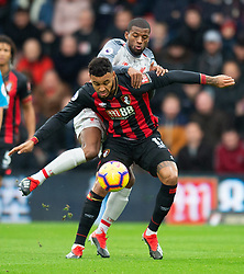 Bournemouth's Joshua King is tackled by Liverpool's Georginio Wijnaldum during the Premier League match at the Vitality Stadium, Bournemouth.
