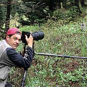 Bio Photos - Daniel J Cox photographing great gray owl chick. Spring. Montana.