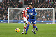Riyad Mahrez of Leicester City passes the ball back. Premier league match, Stoke City v Leicester City at the Bet365 Stadium in Stoke on Trent, Staffs on Saturday 17th December 2016.<br /> pic by Chris Stading, Andrew Orchard sports photography.