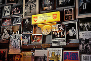 SHOT 6/7/13 4:12:21 PM - A vintage Lone Star Beer sign and old concert posters hang on a wall in the Continental Club on South Congress Avenue in Austin, Texas. The granddaddy of all local music venues, the Continental Club has enjoyed a coast-to-coast reputation as the premiere club for live music in Austin since 1957. Austin, Tx. is the capital city of the U.S. state of Texas and the seat of Travis County. Located in Central Texas on the eastern edge of the American Southwest, Austin is the 11th most populous city in the United States of America and the fourth most populous city in the state of Texas. (Photo by Marc Piscotty / © 2013)