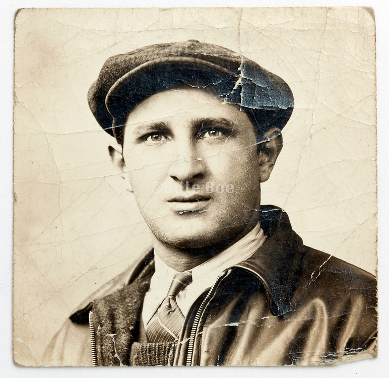 deteriorating vintage photograph with a portrait of an stylish dressed man